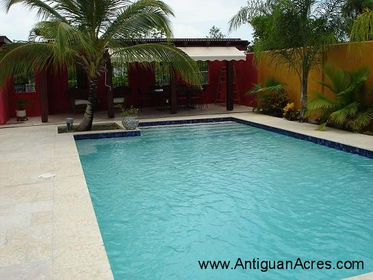 Swimming Pool With Dining Room in Background